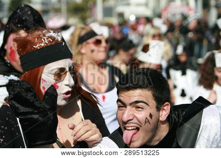 Limassol, Cyprus, March 10th, 2019: Man With His Tongue Sticking Out And Woman With Shocked Facial E