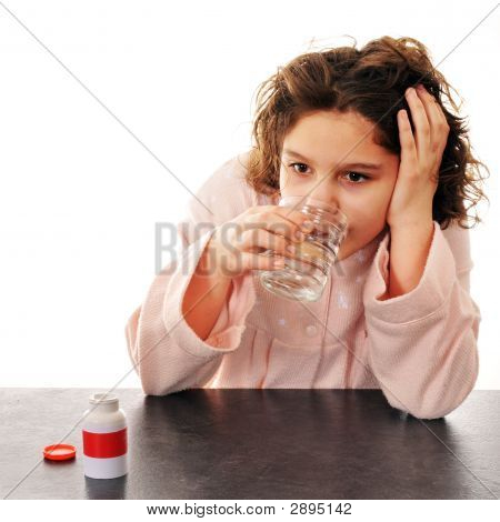 Tween Taking A Pill