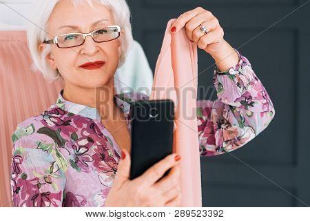 Senior Lady Fashion Blogger. Trendsetter Lifestyle. Elderly Woman Taking Selfie Analyzing Color Type