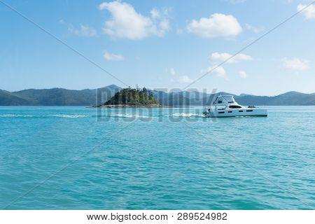 Boat Cruising On Blue Water Of Whitsunday Islands, Australia