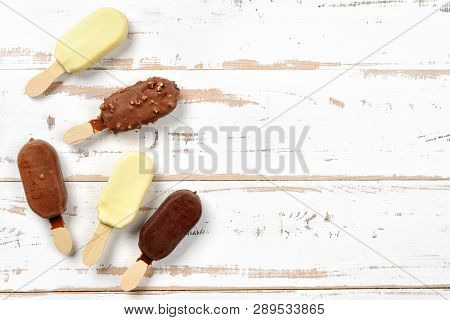 Top View Of Ice Cream Popsicles Covered With Chocolate