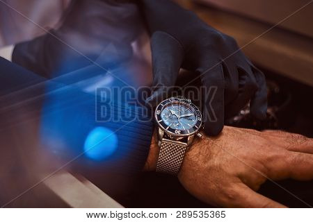 Close-up Hands. Assistant Helps The Client To Try On Exclusive Mens Watches.