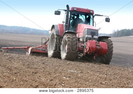 Tractor Working On The Field