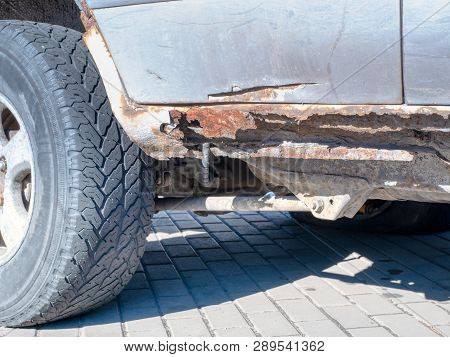 Rusty Bottom Of Old Vintage Car. Close-up Outdoor Image. Impregnation Anti-corrosion Vehicle Body Ca