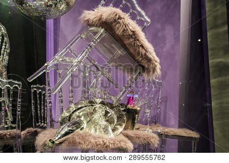 The scattered chairs and glasses, champagne bottles. Exposition. Decorative show-window. Ware. Pink colors. Unusual decision. Chaos. poster