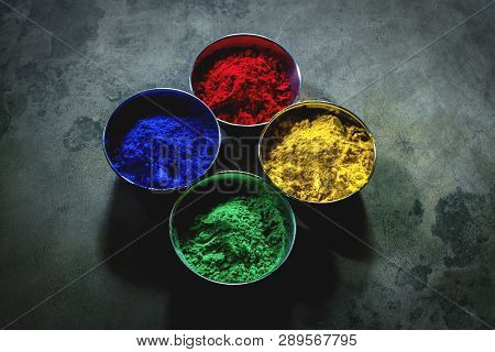 Four Colour Pots Of Gulal For Holi Or Basant Utsav Festival In India And Worldwide