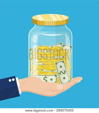 Hand Saver With Glass Jar And Coins Money. Money Jar. Saving Dollar Coin In Jar.save Your Money Conc