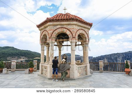 Meteora, Greece - 31 July, 2018: Tourists Take Pictures Of The Bells In The Monastery Of Varlaam Of