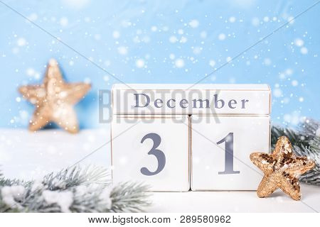 Calendar, Branches Fir Tree And Golden Stars On  Blue Textured  Background. Decorative  New Year Com
