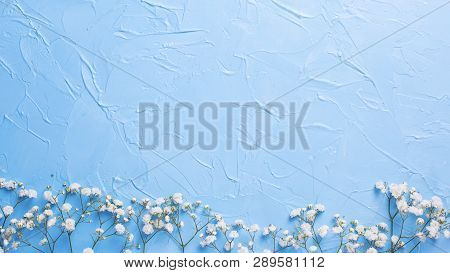 Border  From Fresh White Gypsofila  Flowers On Blue Textured Background. Top View. Flat Lay. Place F