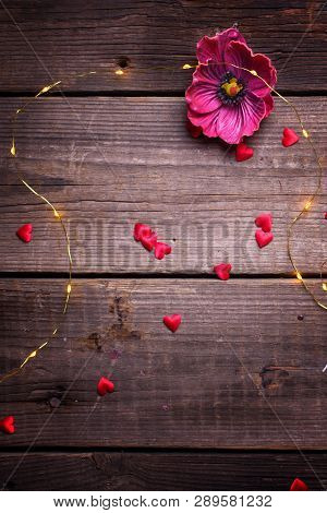 St. Valentine Daybackground. Red  Decorative Hearts, Flower And  Fairy Lights  On  Vintage Textured