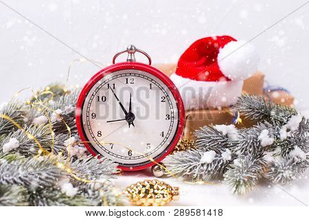 Vintage  Red Alarm Clock, Wrapped  Presents, Santa Hat, Decorative Golden Pine Cones And Fir Tree Br