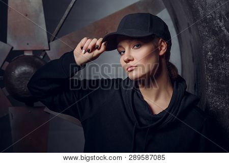 Streetstyle, Fashion. Young Girl Posing On Propellers Background