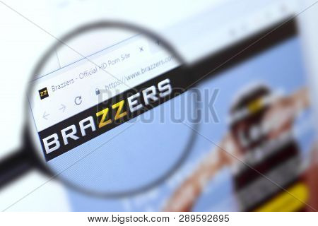Brest, Belarus, March 15, 2019. Brazzers Home Page, View Through A Magnifying Glass. Brazzers Compan