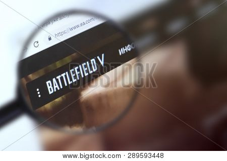 Brest, Belarus, March 15, 2019. The Main Page Of The Site Battlefield 5, View Through A Magnifying G