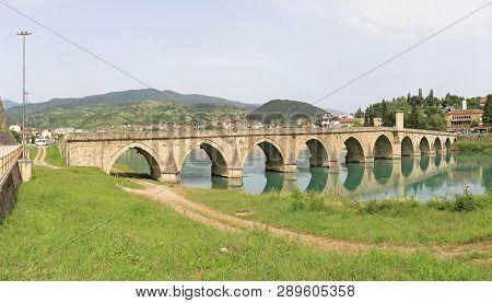 Visegrad, Bosnia And Herzegovina - June 12, 2010: Mehmed Pasha Sokolovic Old Ottoman Bridge At River