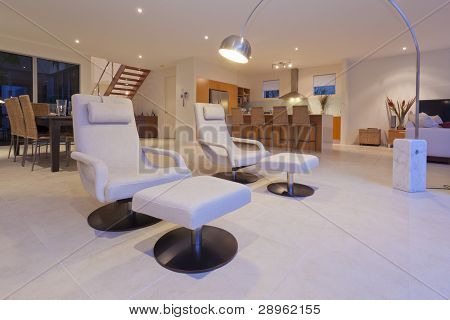 Stylish living room and kithchen with modern recliner chairs and lamp poster