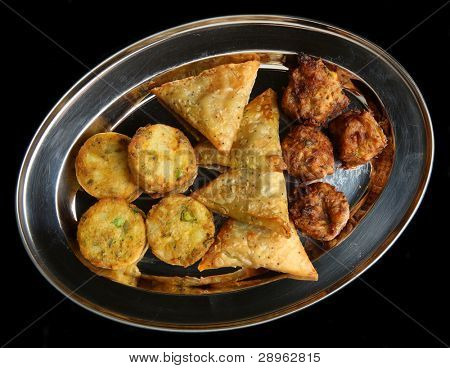 Selection of Indian samosa, bhaji and pakora