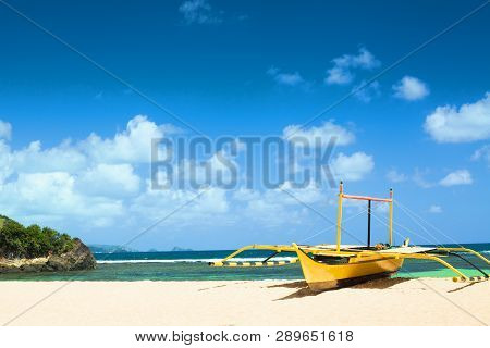 Yellow Boat On The Beach Of The Pacific Ocean.
