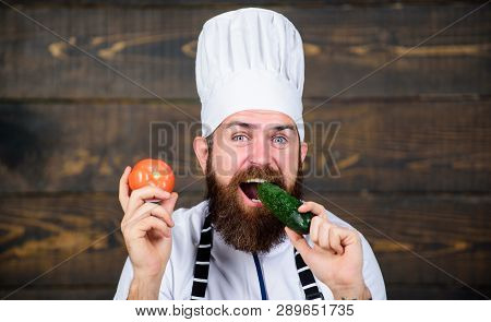 Healthy Raw Food. Dieting Concept. Man Wear Hat And Apron Hold Tomato. Healthy Nutrition. Bearded Hi