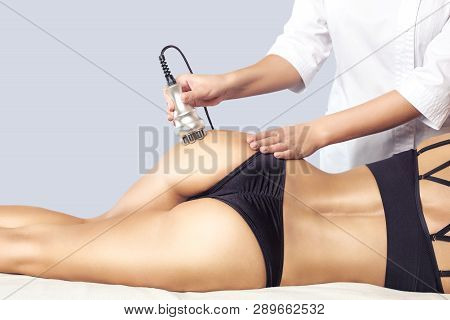 The Doctor Does The Rf Lifting Procedure On The Legs, Buttocks And Hips Of A Woman In A Beauty Parlo