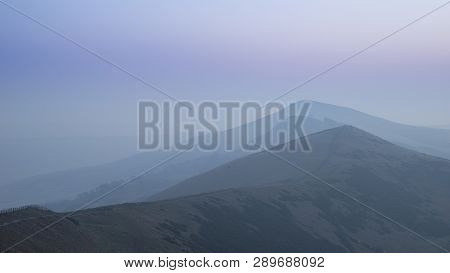 Beautiful Winter Sunrise Landscape Image Of The Great Ridge In The Peak District In England With Mis