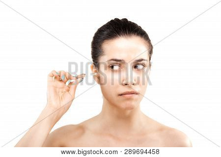 Girl With Cotton Ear Stick Making Grimace