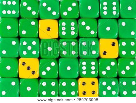 Pattern Background Of Random Ordered Green Dices With Four Yellow Cubes