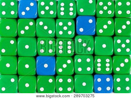 Pattern Background Of Random Ordered Green Dices With Four Blue Cubes