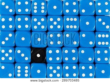 Pattern Background Of Random Ordered Blue Dices With One Black Cube