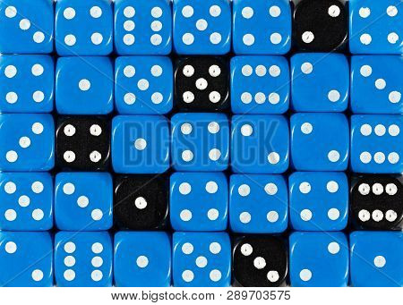 Pattern Background Of Random Ordered Blue Dices With Six Black Cubes