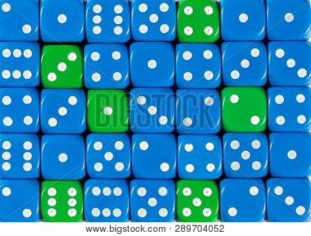 Pattern Background Of Random Ordered Blue Dices With Six Green Cubes