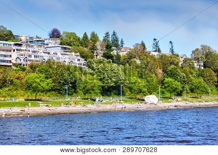 Oceanfront Houses Along White Rock Beach On Semiahmoo Bay In British Columbia, Canada. The Quaint Se