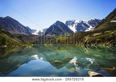 Beautiful Mountain Lake With Turquoise Clear Water In The Altai Republic Siberia Russia. Reflection