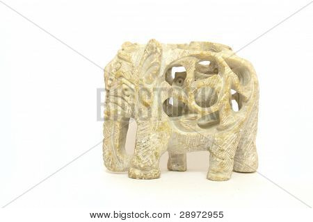 The Carved Flinty Elephant Within Elephant Calf  Isolated At The White Background.