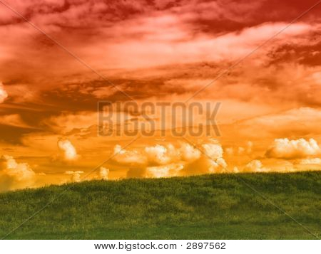 rural landscape with green grass and red sky poster