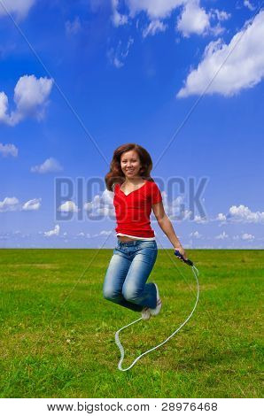 Young woman with skipping rope