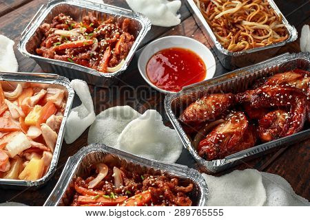 Chinese Takeaway Food. Crispy Shredded Beef, Sweet And Sour Chicken Wings, Egg Noodles With Bean Spr