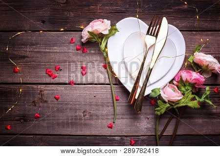St. Valentine Day Table Setting.white Plates In Form Of Heart, Cutlery, Red  Decorative Hearts, Flow