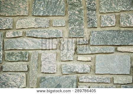 Close Up Of Colorful Background Of Stone Wall