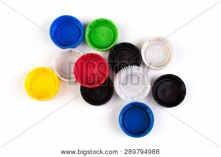 Many Plastic Covers Of Different Colors, Isolated On White Background.