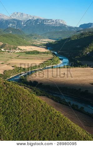 the Vjosa river flowing in a valley between the albanian mountains poster