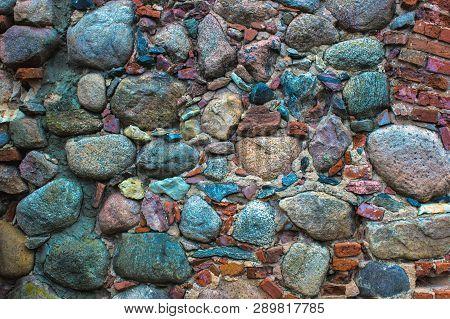Old Stone Wall. Beautiful Stone Wall. Damaged Stone Wall. Stone Background. Old Wall.