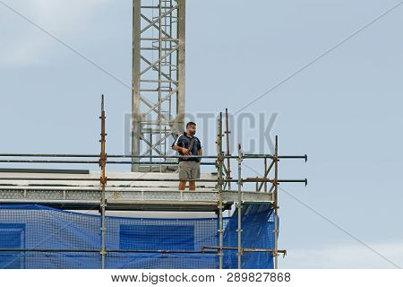 Gosford, New South Wales, Australia - January 31, 2019: Crane Operator Remotely Controlling A Workin