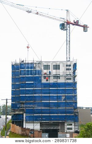 Gosford, New South Wales, Australia - February 21, 2019: Removing Scaffolding And Safety Netting On