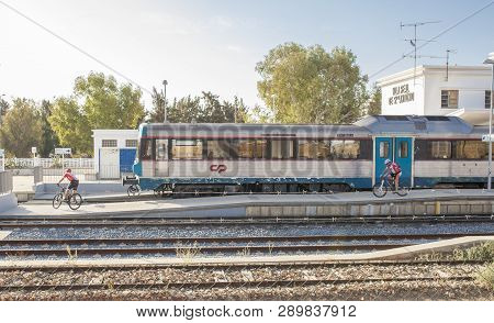 Vr Sto Antonio, Portugal - Sept 30th, 2017: Mountain Bikers Getting Down From Train At Railway Stati