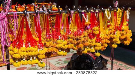 Hanging Flower Garland in Chinese Buddhist Temple, material offerings of traditional Mahayana Buddhist devotional practices for accumulation of merit. Religion, Travel Asia, Culture and Symbol concept poster