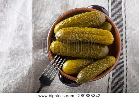Pickled Gherkins With Mustard And Garlic On A Stone Rusty Background.
