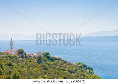 Igrane, Dalmatia, Croatia, Europe - Church Spire On Top Of The Mountain Of Igrane