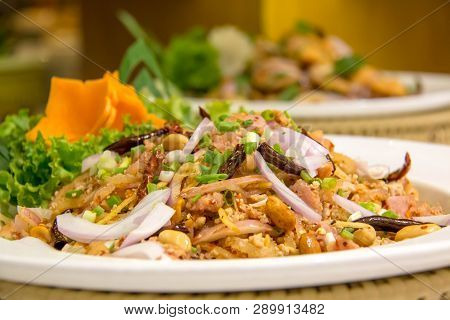 A Thaifood  Spicy Salad In White Dish